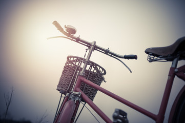 beautiful landscape image Vintage red Bicycle with Basket  at su