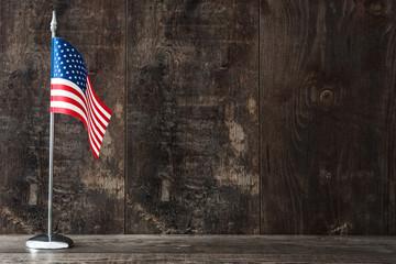 United States flag on a rustic wooden background