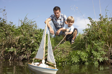Father and son with boat
