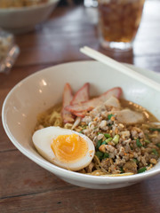 Spicy noodles with egg and pork ( Thai style food )