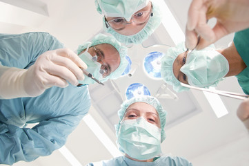 Low angle view of doctor and nurses in operating room