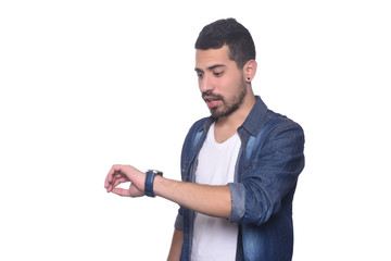 Portrait of latin man looking at his watch .