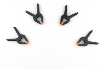 Group black palstic clamp, top view