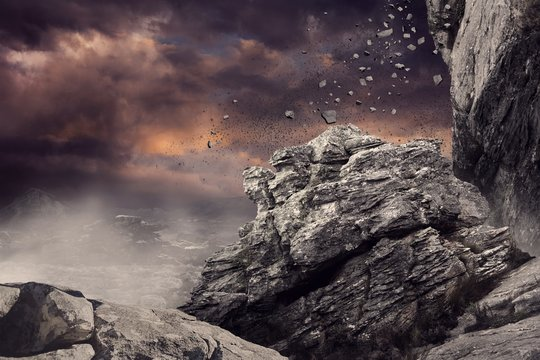 Rock crashing down from cliff