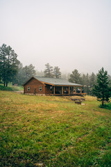 Log cabin with porch in the forest
