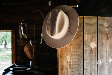 Cowboy hat hanging on open door