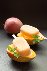 Mango sorbet ice cream popsicles.