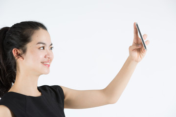 Young asian lady taking a selfie