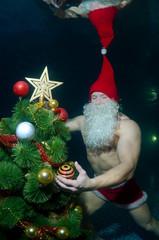 Underwater Santa Claus in the pool