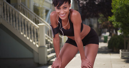 Athletic healthy black woman runner resting during jog on San Fr