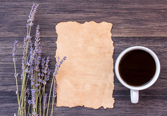 Old paper and coffee on dark wooden table background.