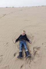 Young Boy Fun At Dutch Dunes