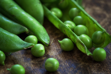 Organic green peas on wooden table