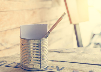 Paper and pencil in a Tin can for Food order.
