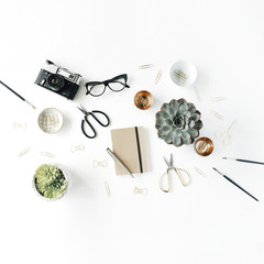 feminini desk workspace with succulent, retro camera, scissors, diary, glasses and golden clips on white background. flat lay, top view