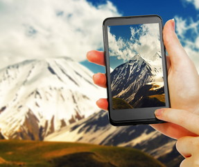 taking photo of the mountain landscape