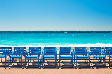 Fotorolgordijn Nice Blue chairs on the Promenade des Anglais in Nice, France