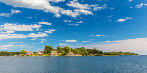 Panoramic image of a small swedish island with old houses