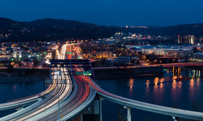 Traffic streaks across the Fort Hill Bridge in downtown Charleston, West Virginia