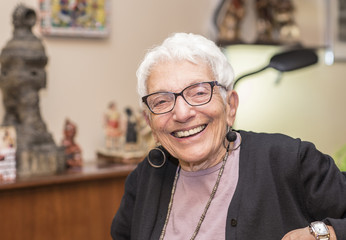 Older Independent Woman in her Apartment Smiling & Happy
