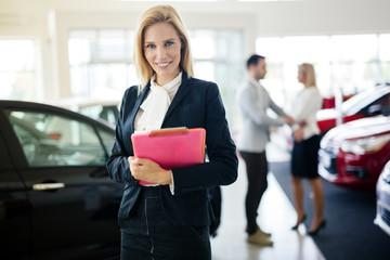 Professional saleswoman at dealership