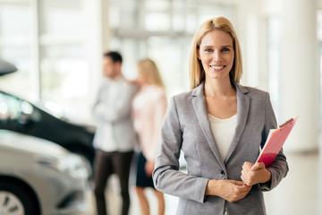 Salesperson working at car dealership