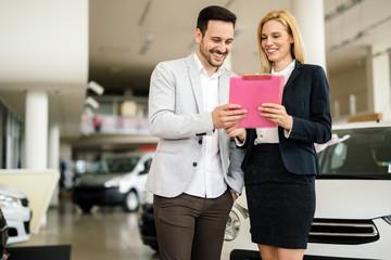 Customer looking at cars at dealership