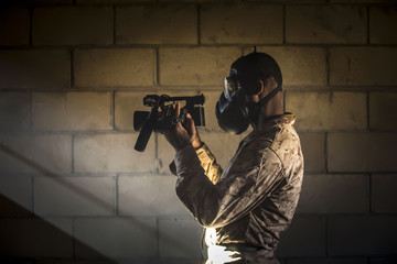 Military in the mask and with the camera