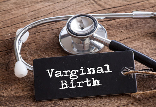 Varginal Birth words written on label tag with Stethoscope on wood as medical concept