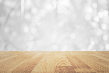 wood table in front of white bright bokeh lights