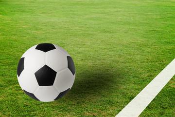Soccer ball on green field