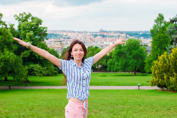 Young caucasian woman enjoy beautiful woman of european old city from the observation place
