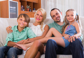 Smiling family with two kids