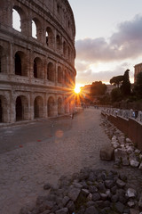 Colorful sunset at the Roman Colosseum in Rome, Italy