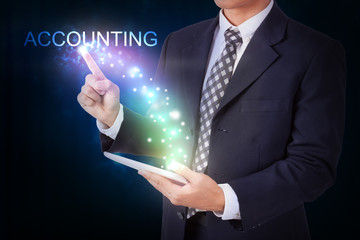 Businessman holding tablet with pressing accounting. internet and networking concept