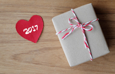 2017 on red fabric heart shape and gift box on wood background