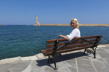 Female Tourist In Chania Port Crete Greece