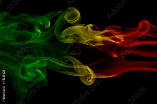 Smoke background reggae colors green, yellow, red colored in flag of