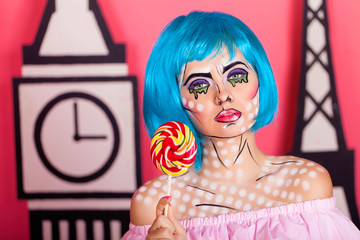 Photo of young woman with professional comic pop art make up. Creative beauty style.