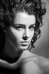 Portrait of beautiful woman with curly hair, black and white