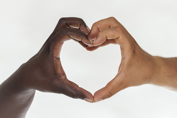 White and brown hands in heart shape. White background