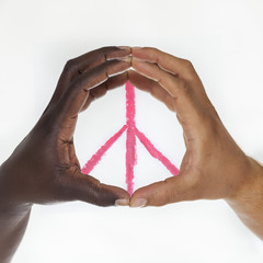 Interracial hands  forming  symbol of peace. White background