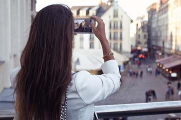 Tourist woman taking mobile phone picture at Italy vacation