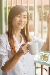 Young  beautiful woman drinking coffee.selective focus