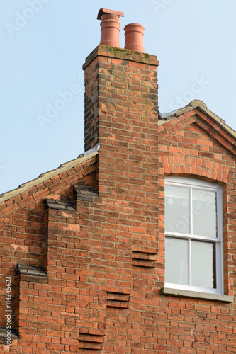 Chimney T With A Series Of Steps Leading Up To Roof On Victorian House