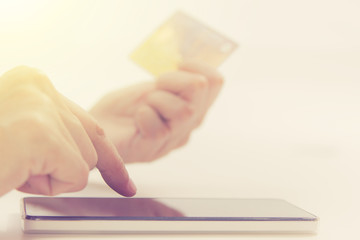 Online payment, hands holding a credit card and using smart phon