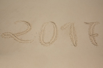 2017, message written in the sand at the beach