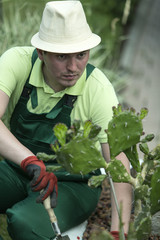 Russia. Belgorod region. Young man in the summer garden.