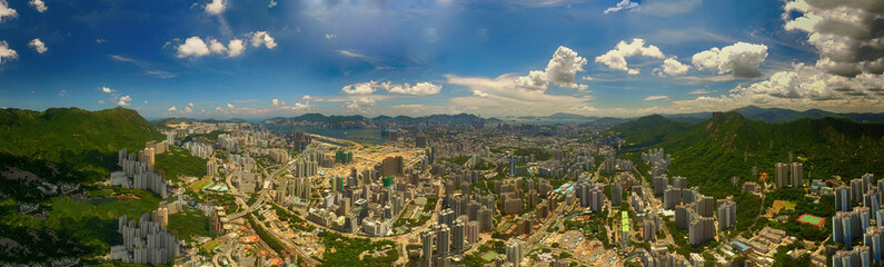 Aerial view of Hong Kong Scene with Victoria Harbour in sunny day