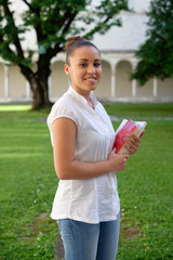 Student girl portrait holding books in her hands
